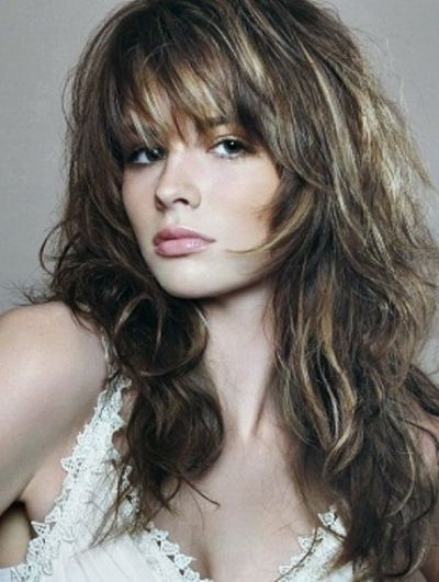 wavy long layered haircut with bangs