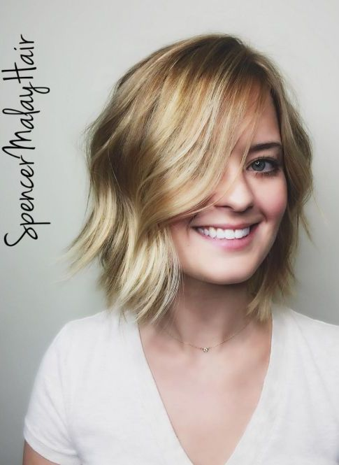 Beachy blonde wavy layered bob haircut