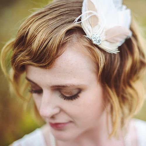 wavy short wedding hair with feathers