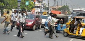 Indians crossing road