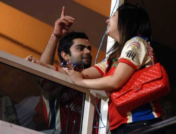 Virat Kohli talking with a woman