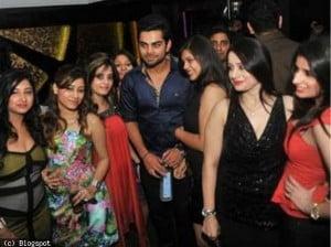 Virat Kohli with girls at IPL party