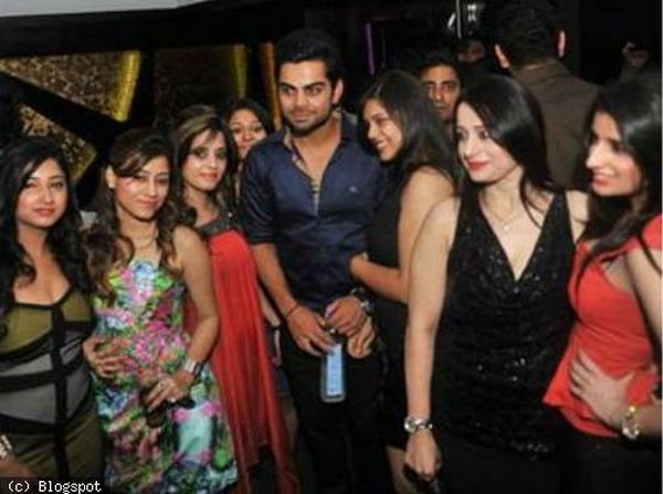 Virat Kohli with girls at IPL party