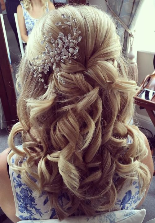Half up half down hairstyle with hair accessory
