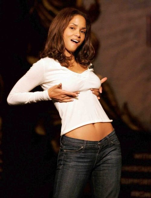 Actress Halle Berry gestures while being honored as Harvard's Hasty Pudding Woman of the Year at Harvard University in Cambridge, Massachusetts February 16, 2006. Hasty Pudding Theatricals honors an actor and actress each year with a humorous roast and a pudding pot.REUTERS/Jessica Rinaldi