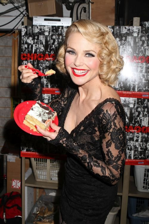 Christie Brinkley and the cast of Chicago celebrate the 6000th performance of Chicago on Broadway, with cake and champagne during intermission of the performance, backstage at The Ambassador Theatre in New York City.