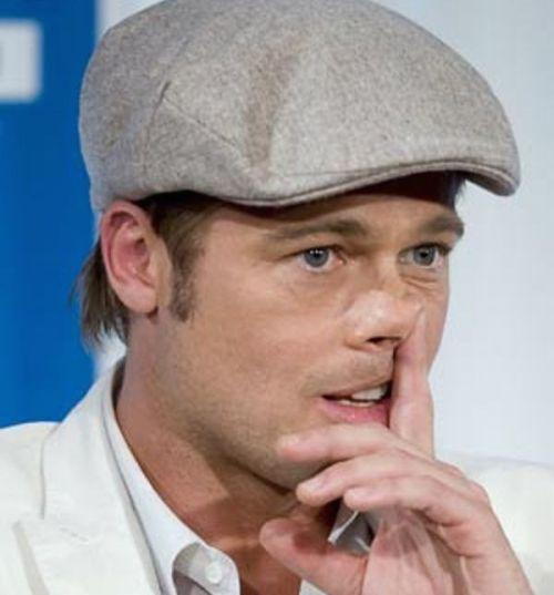 Brad Pitt picking nose