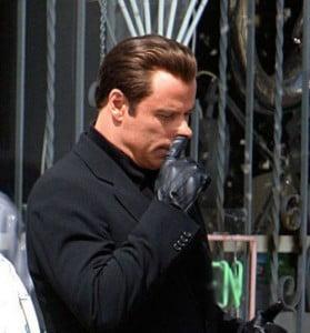 John Travolta picking nose