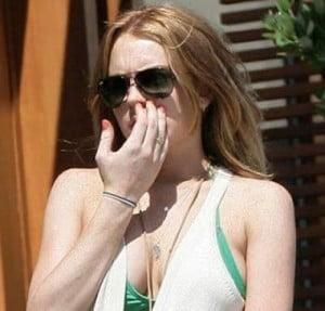 Lindsay Lohan picking nose