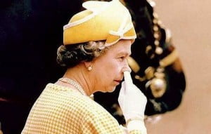 The Queen picking nose
