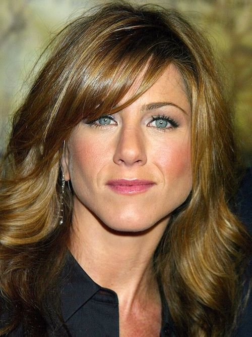 uneven side swept bangs jennifer aniston
