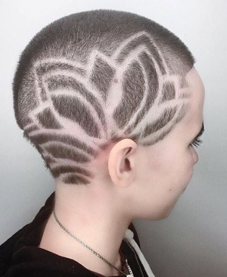 Artistic buzz haircut for women