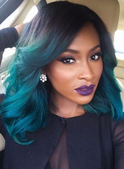 Electric blue hair color on a long bob hairstyle