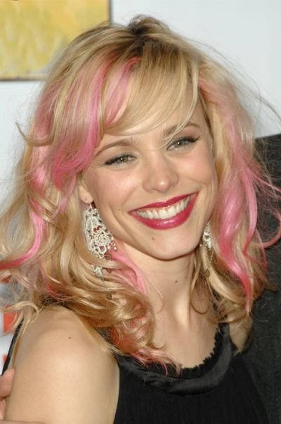 Light golden blonde hairstyle with pink highlights