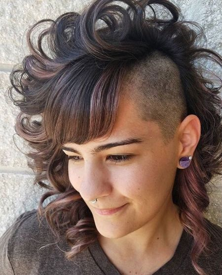 Medium curly and undercut hairstyle for women