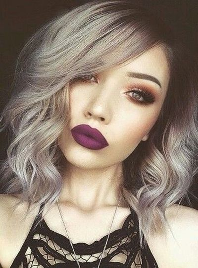 Short curled silver grey hair