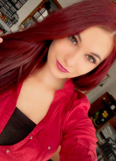 Deep burgundy hair color for warm skin tone