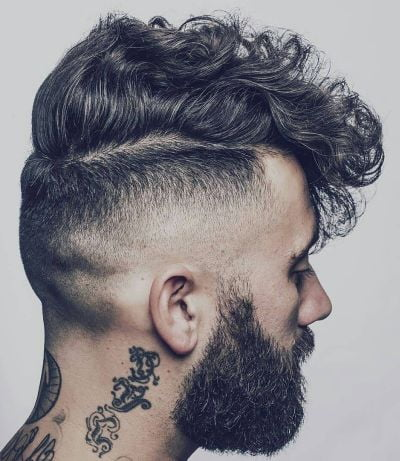 Front combed curly hair with high fade