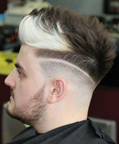 High fade cut with white streak