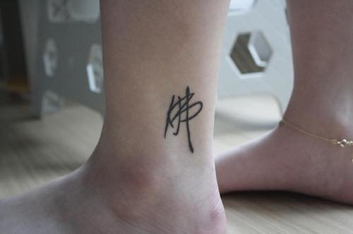 ankle mini tattoo abstract