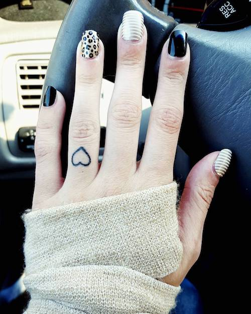 ring finger heart tattoo