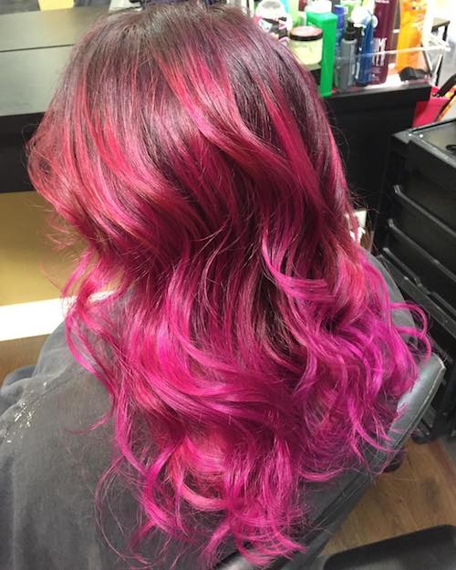wavy hair with hot pink highlights