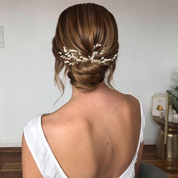 backless wedding dress with chignon