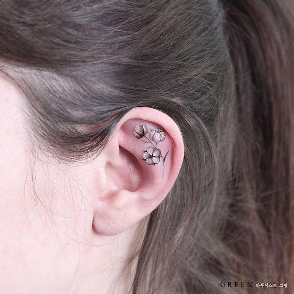 cotton flower ear tattoo