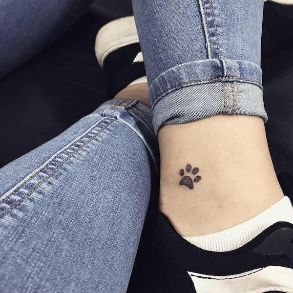 paw print ankle tattoo