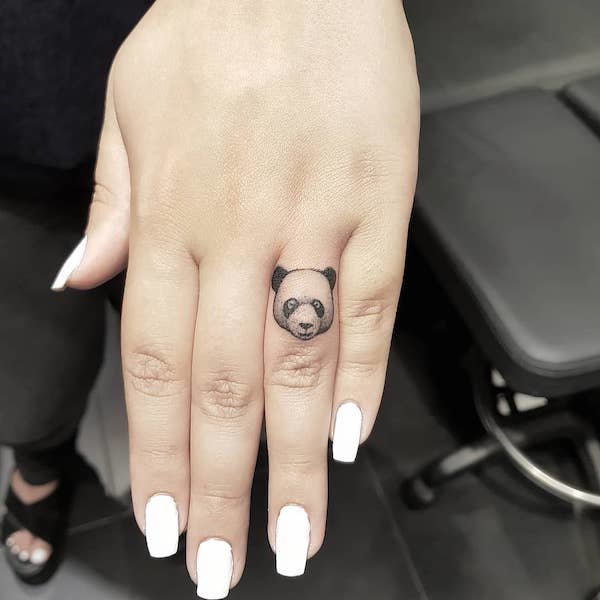 Ring finger panda tattoo